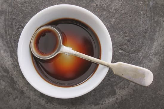 full bowl of Worcestershire sauce with teaspoon